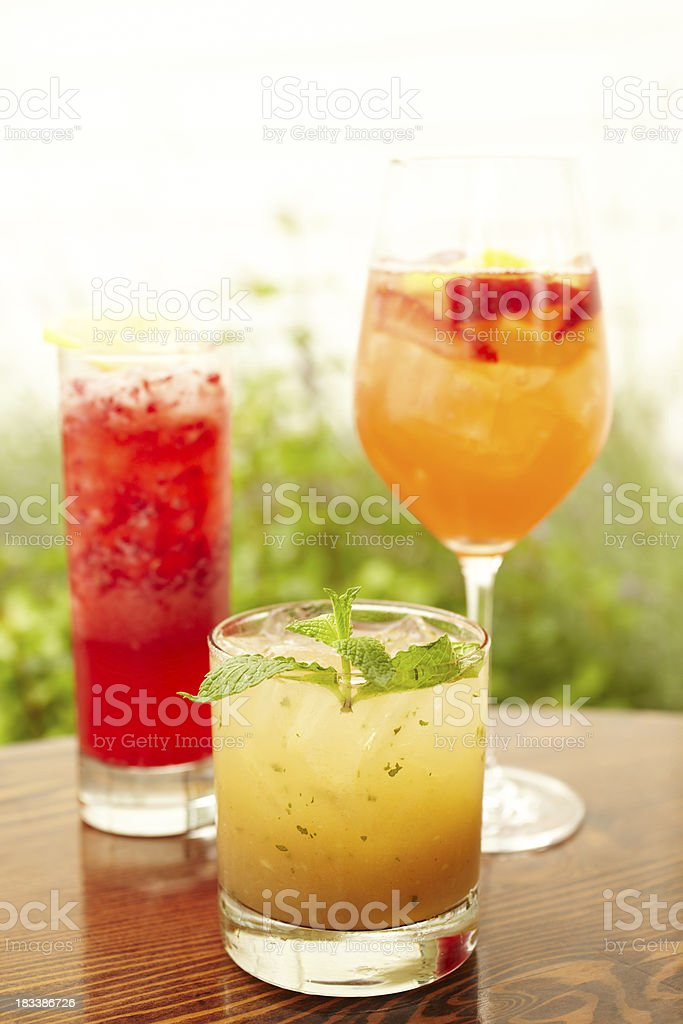 Three fancy cocktails on outdoor bar stock photo