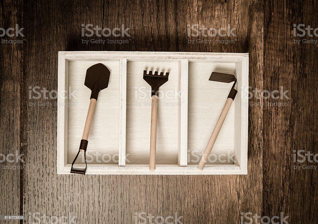 Three farm tools in the white box stock photo
