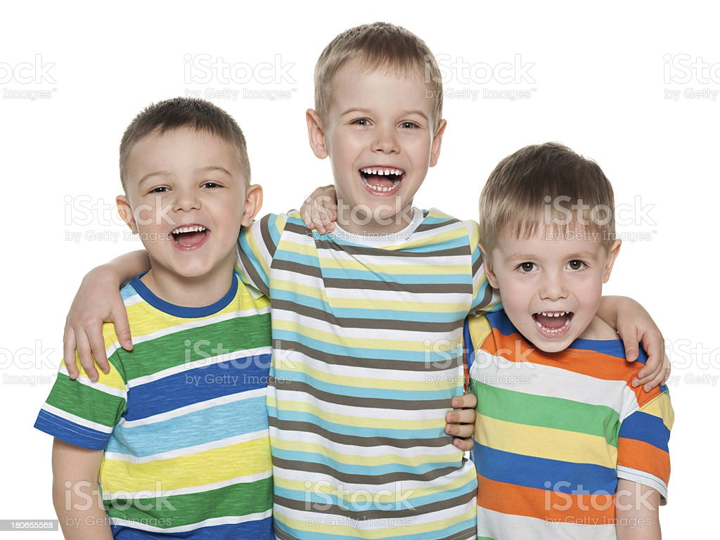 Three fashion laughing boys stock photo