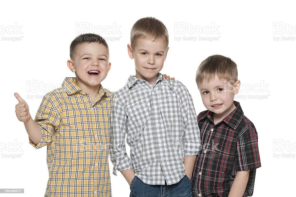 Three fashion young boys on the white royalty-free stock photo