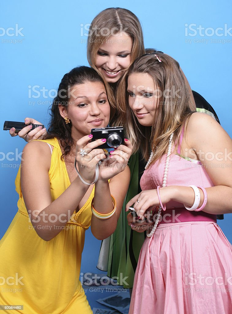 Three female friends with a camera royalty-free stock photo