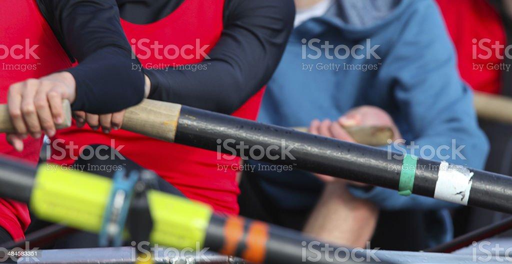 Three Female Hands Rowing stock photo