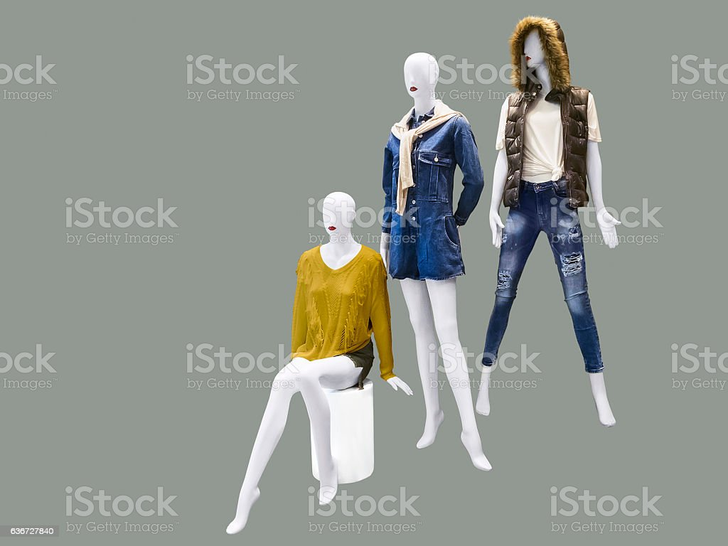 Three female mannequins stock photo
