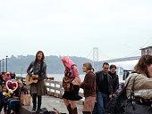 Three female street musicians jam at the Farmers Market
