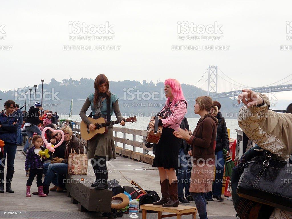 Three female street musicians jam at the Farmers Market stock photo