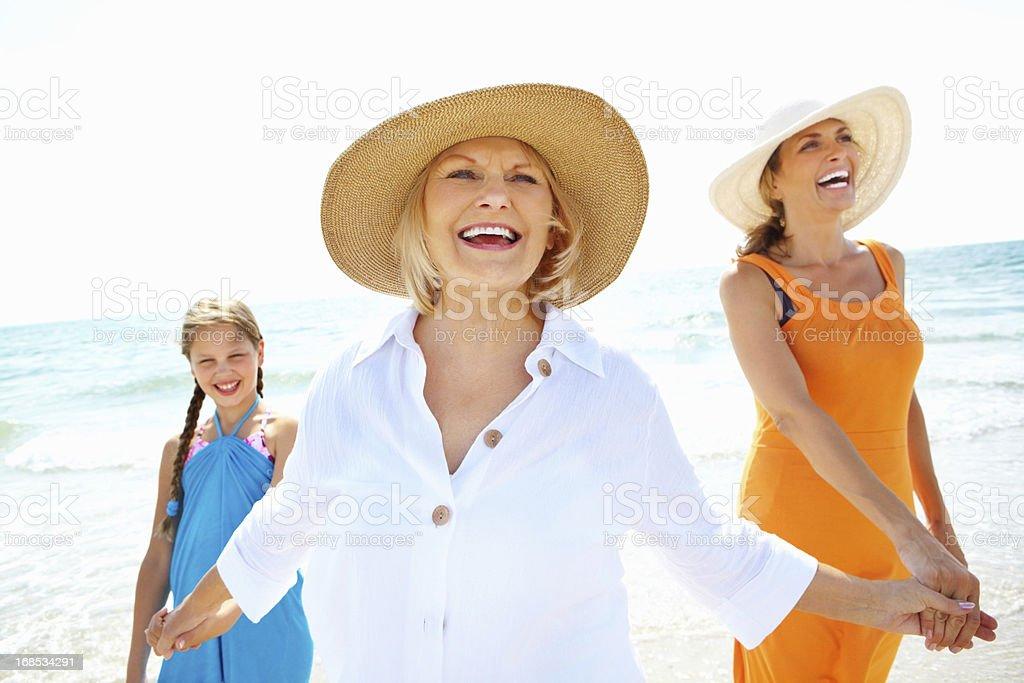 Three females smiling on the beach royalty-free stock photo