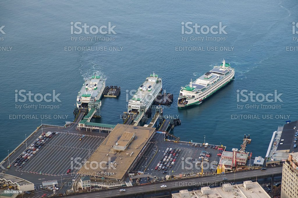 Three ferry boats at terminal stock photo