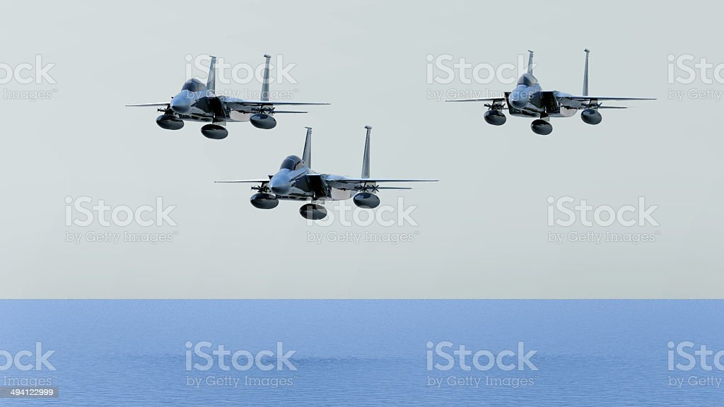 Three fighter planes flyingon the sky stock photo