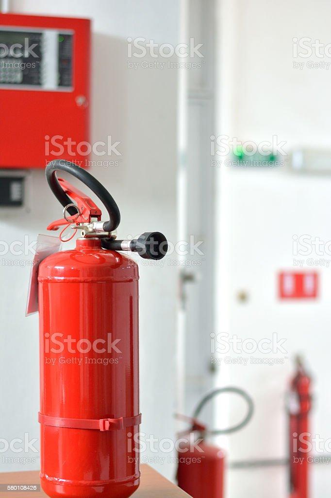 Three Fire Extinguishers and Fire Alarm Box stock photo