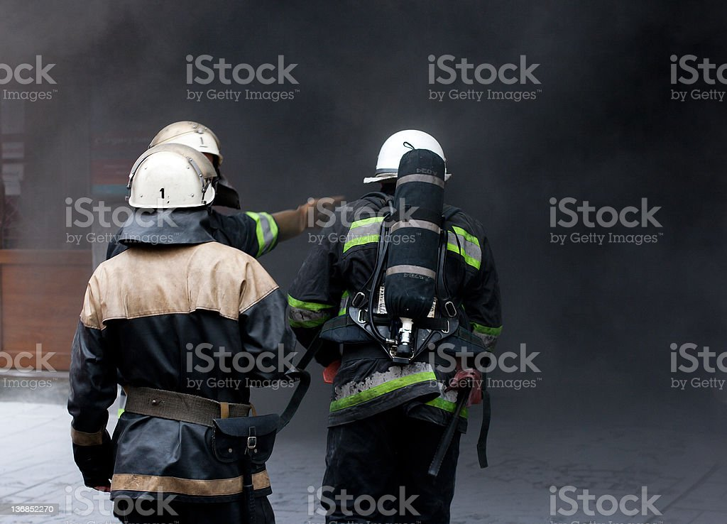 Three Firefighters, going to rescue in a fire. royalty-free stock photo