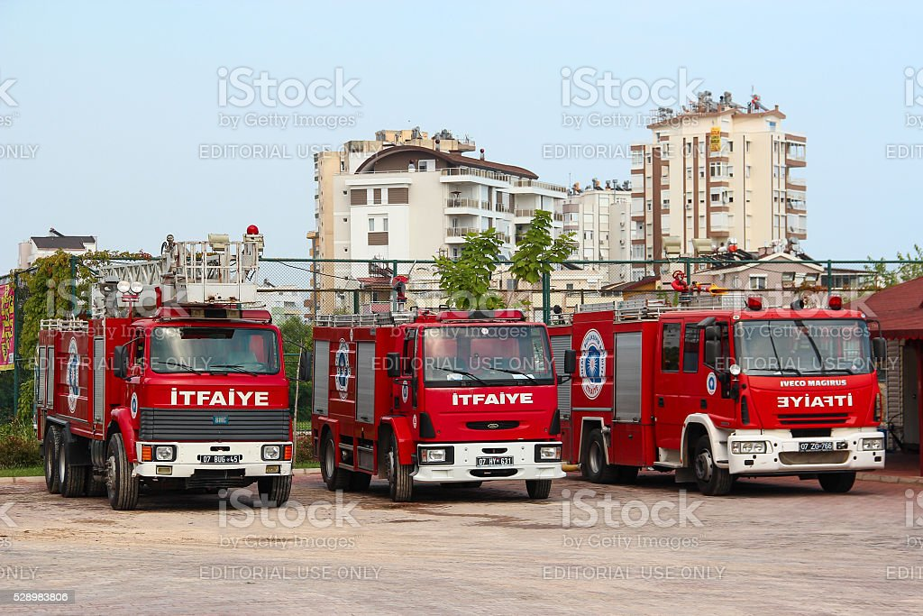 Three firetruck standing on the street, near the fire department stock photo
