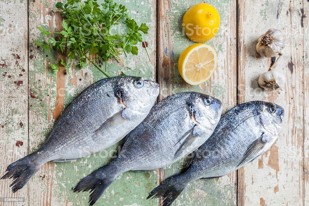 Three fish on  a table stock photo