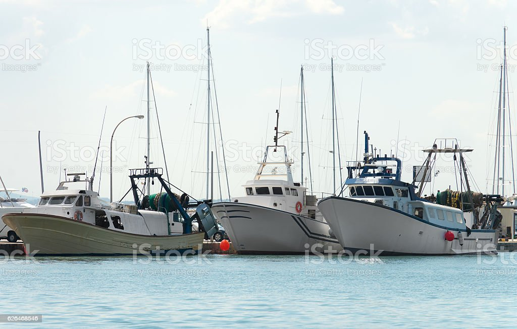 Three fishing vessels in the port. stock photo