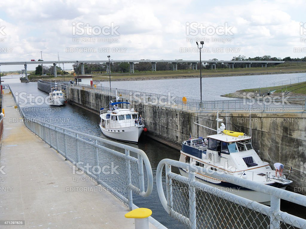 Three fishing yachts wait in the Port Mayaca Lock stock photo