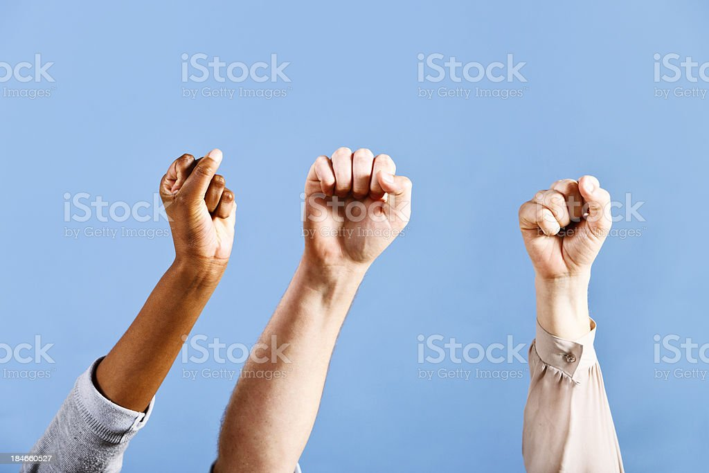 Three fists give an air punch of solidarity royalty-free stock photo
