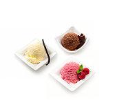 Three flavours of icecream on white