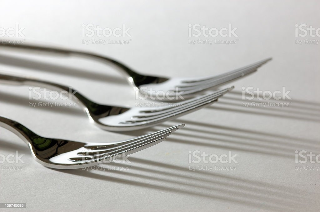 three forks with shadows royalty-free stock photo