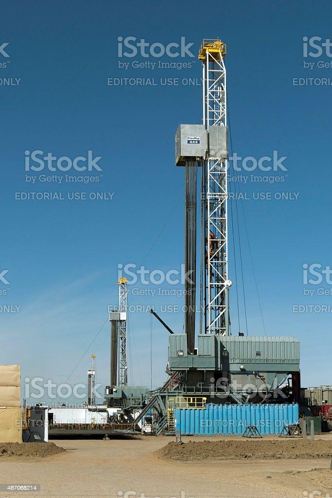 Three fracking drill rigs in a row Greeley Colorado farm stock photo