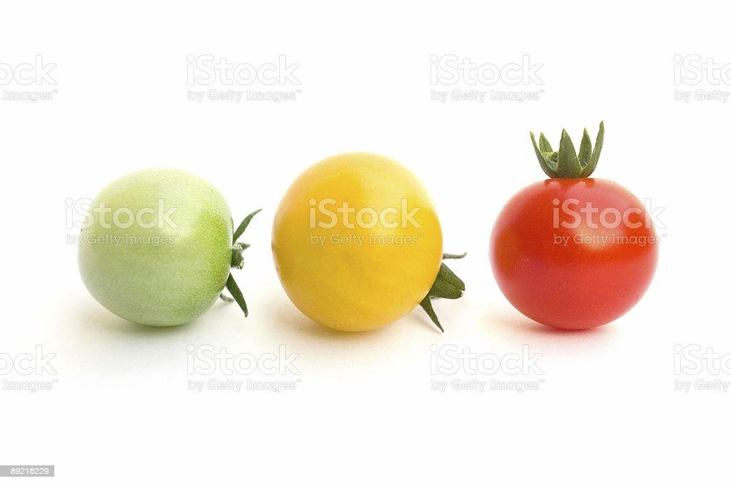 Three fresh and raw tomatoes stock photo