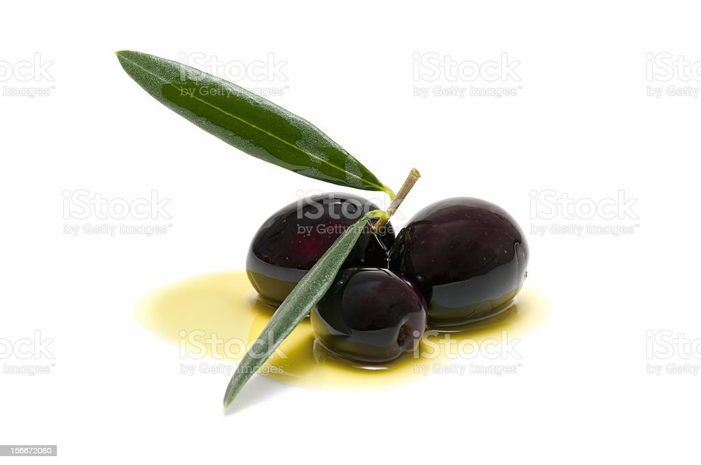 three fresh olives bathed in olive oil royalty-free stock photo