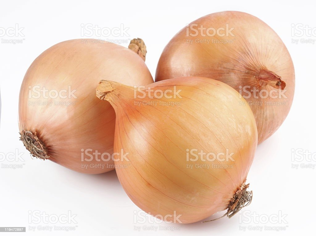 Three fresh onion bulbs on white background stock photo