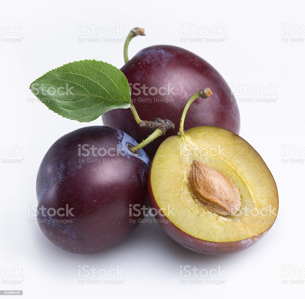 Three fresh plums isolated on white background stock photo