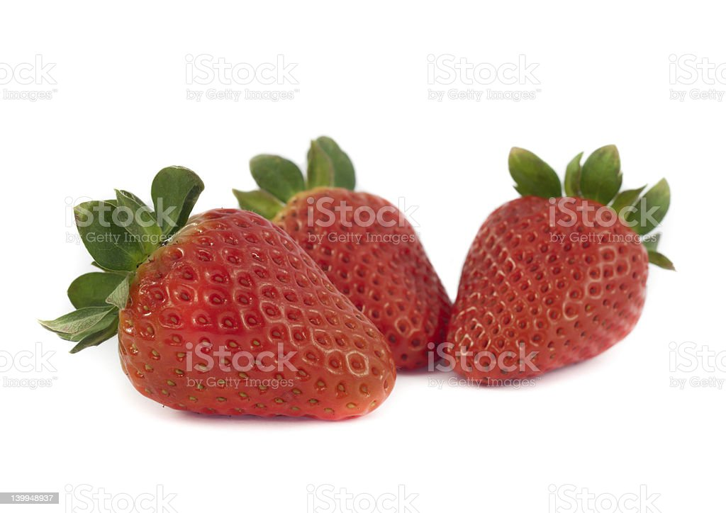 Three fresh strawberries stock photo