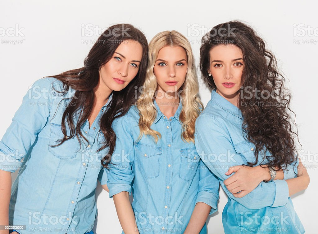 three friend women in jeans clothes stock photo