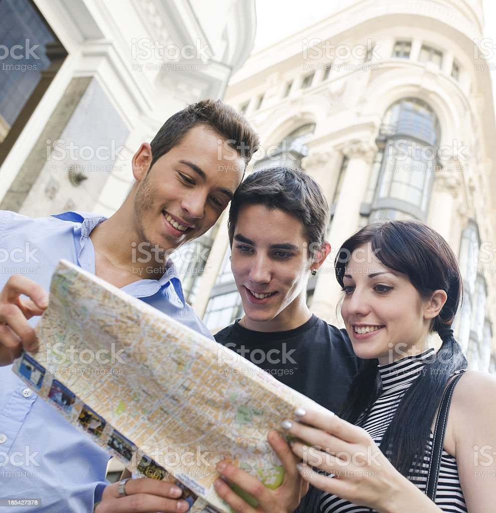 Three friends and a map stock photo