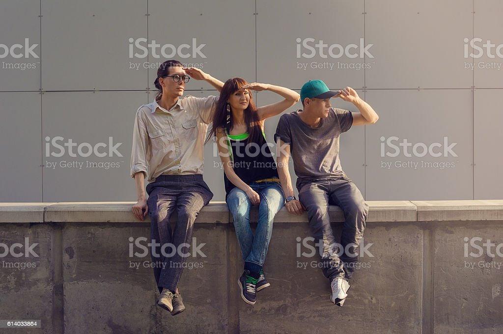 Three friends are looking into the distance stock photo