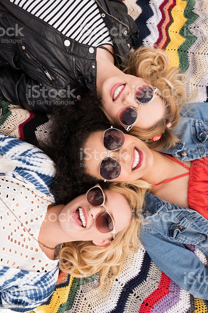 Three friends at the festival stock photo