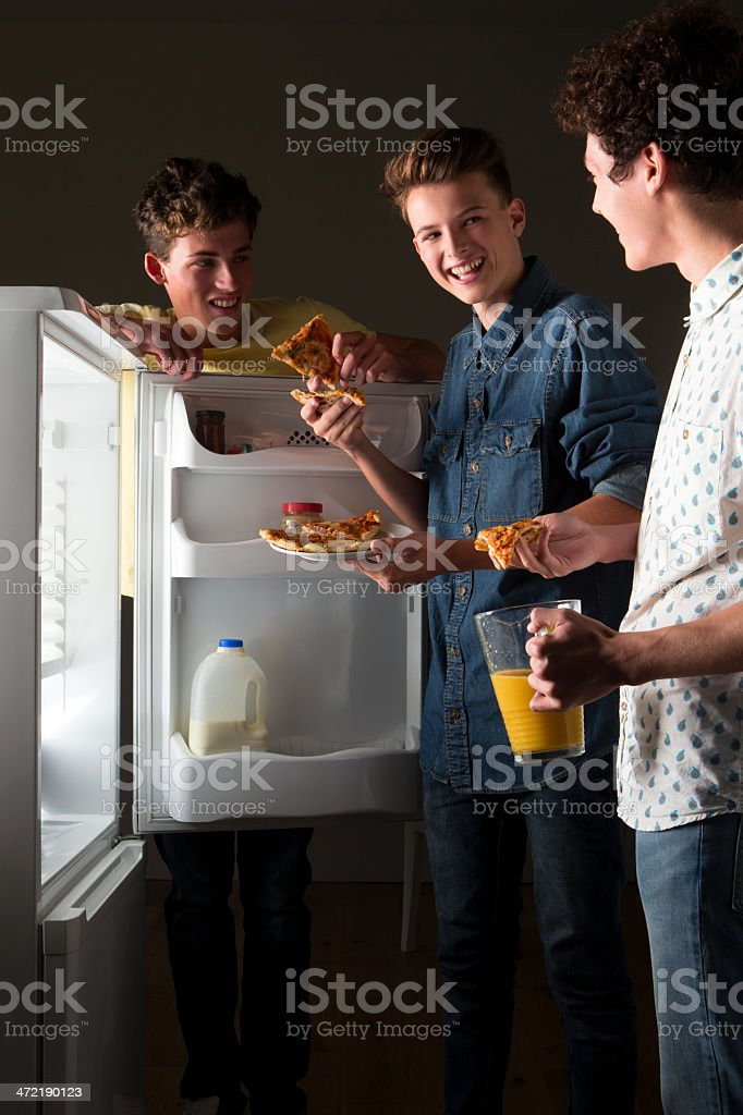 Three Friends Eating Pizza royalty-free stock photo