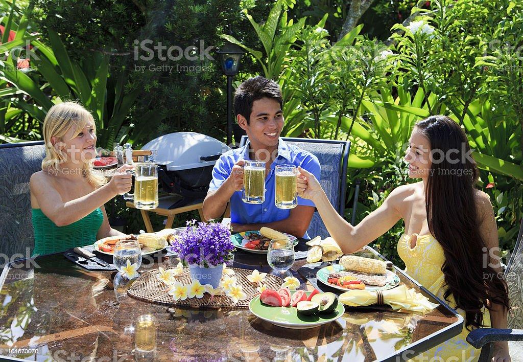 three friends having a barbecue stock photo