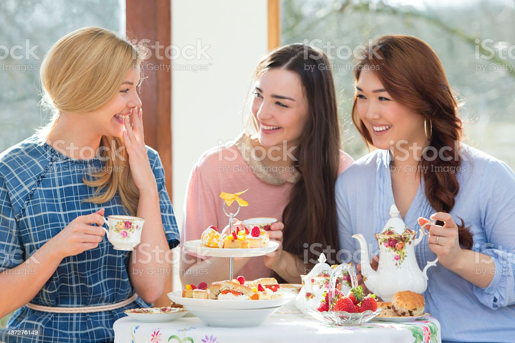 Three Friends Having Afternoon Tea stock photo