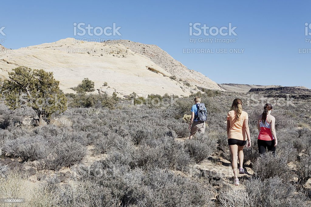 Three friends hiking in St. George, Utah royalty-free stock photo