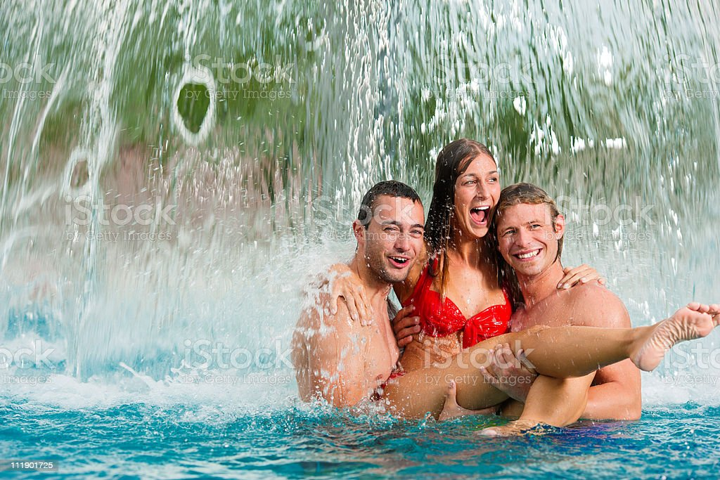 Three friends in public swimming pool royalty-free stock photo