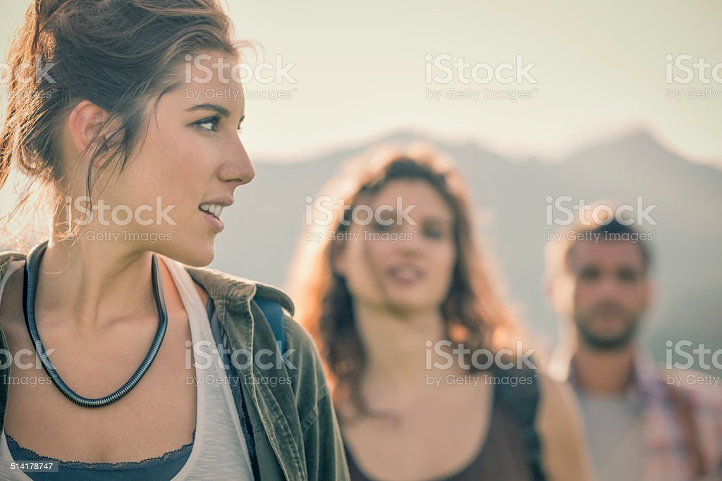 Three friends portrait on mountain in sunny day stock photo