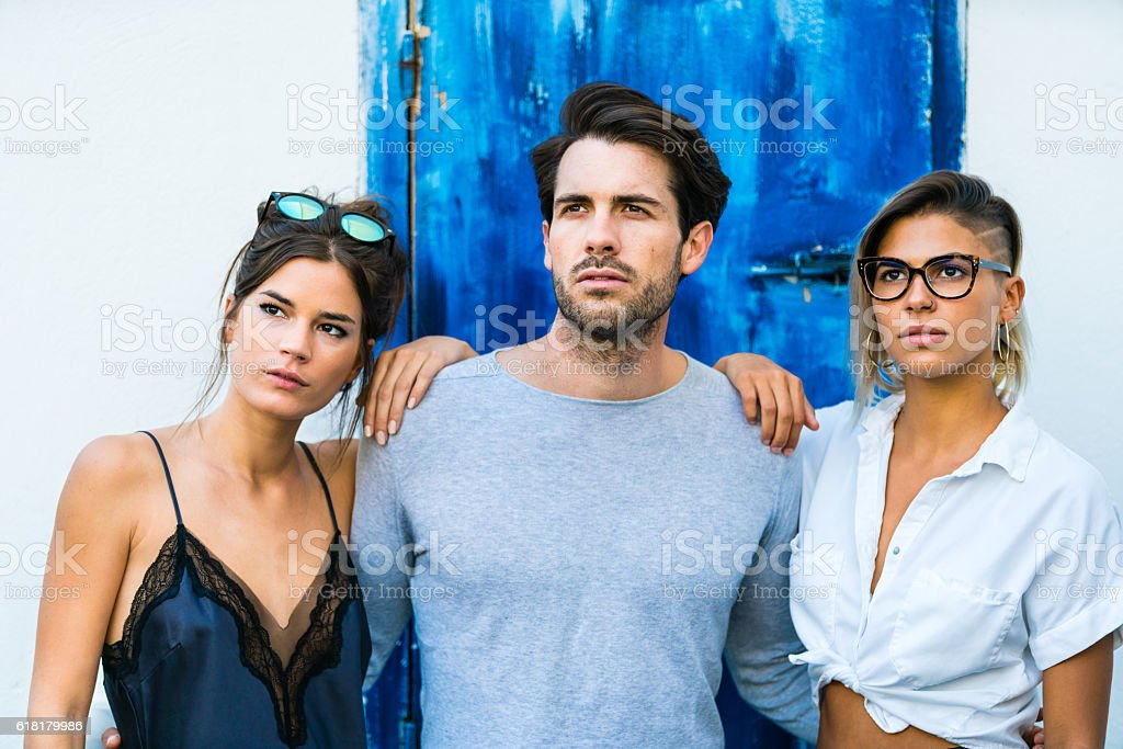 Three friends posing at outdoor bar stock photo