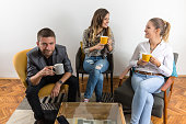 Three friends relaxing and drinking coffee