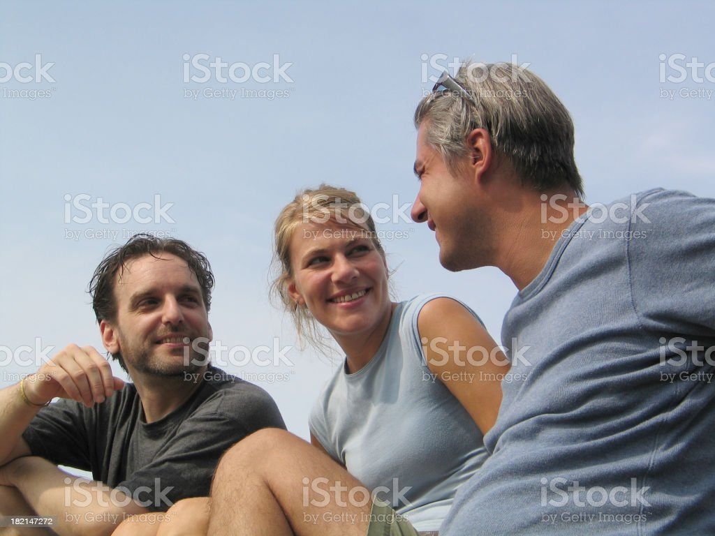 Three friends talking outdoors royalty-free stock photo