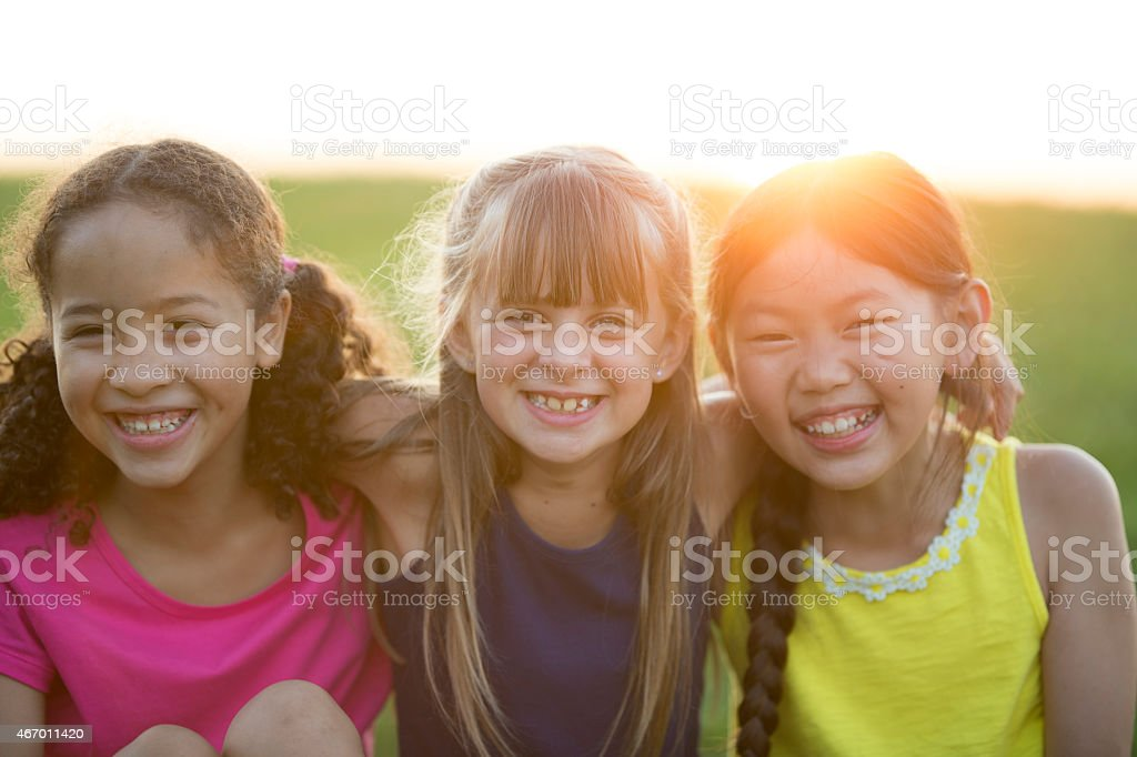 Three Friends Together Outdoors stock photo