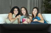 Three friends watching romantic movie on tv