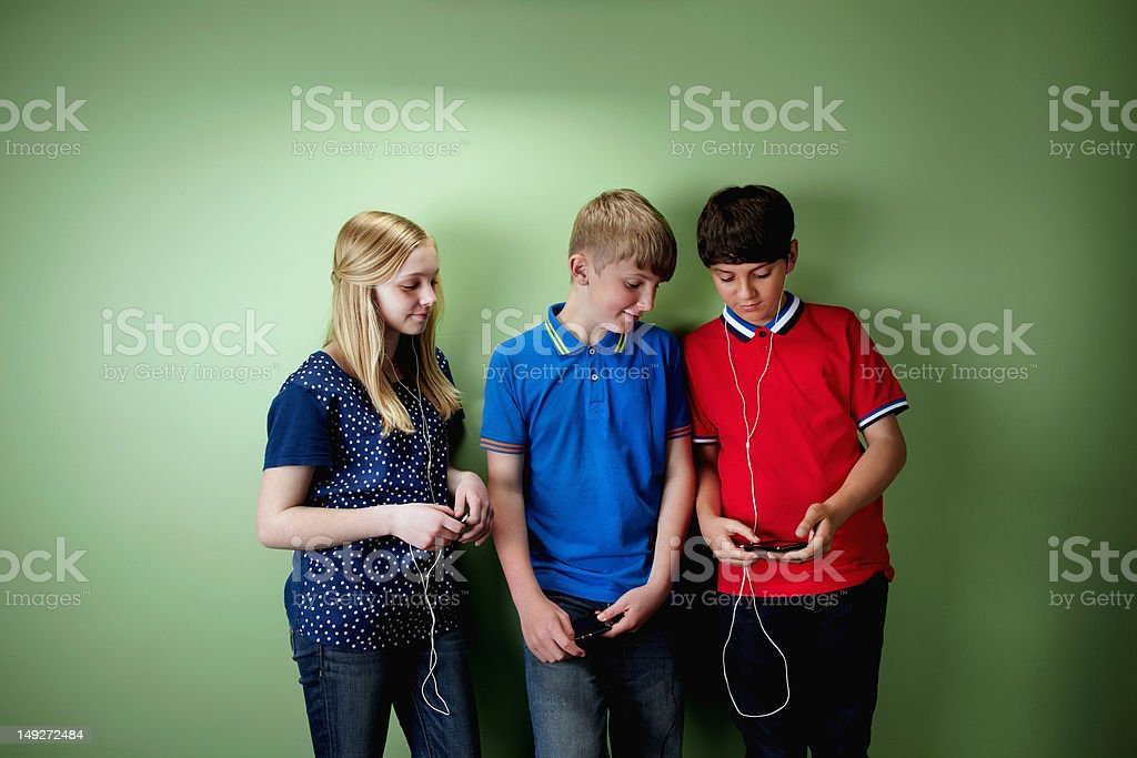 Three friends with mp3 players stock photo