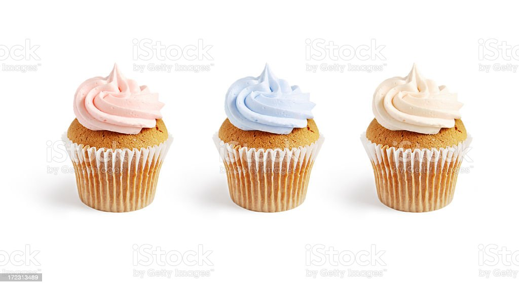 Three frosted vanilla cupcakes with pink and blue frosting royalty-free stock photo