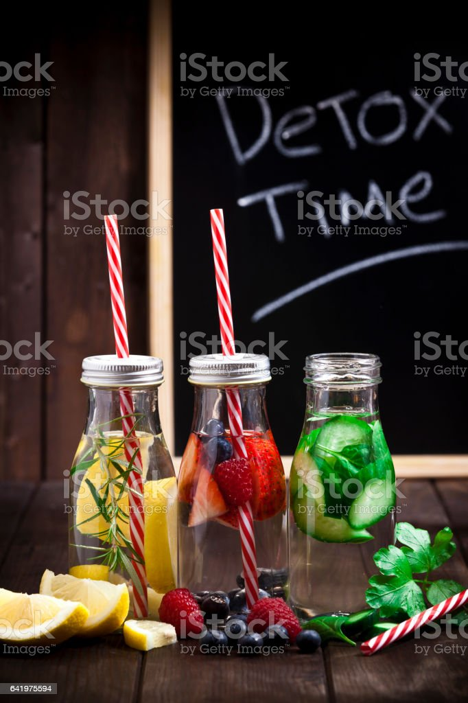 Three fruits and vegetables infused water detox drinks stock photo
