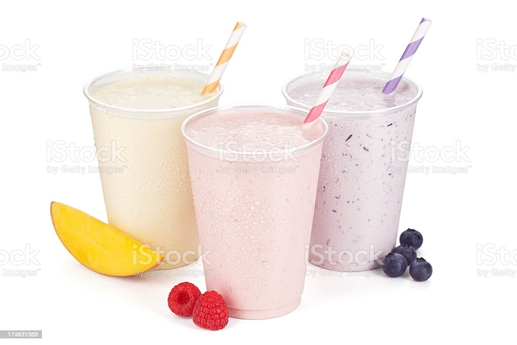 Three Fruity Flavors Of Frosty Yogurt Smoothies royalty-free stock photo
