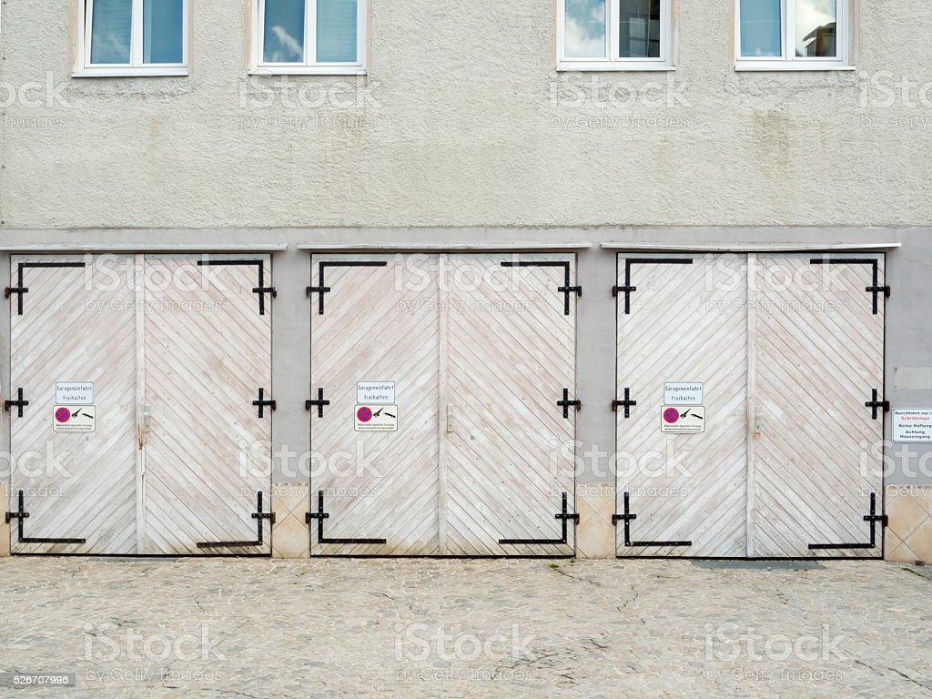 three garage doors stock photo