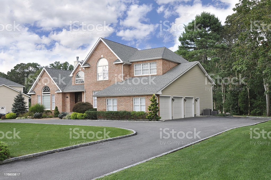 Three Garage Large Luxury Suburban Home stock photo