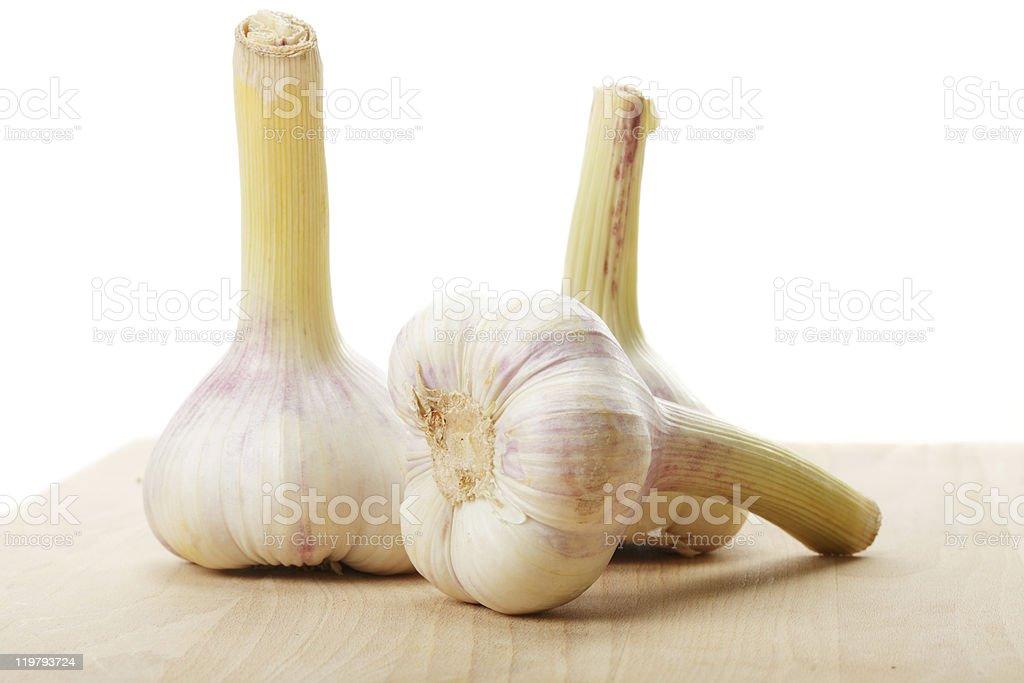 Three garlic bulbs stock photo