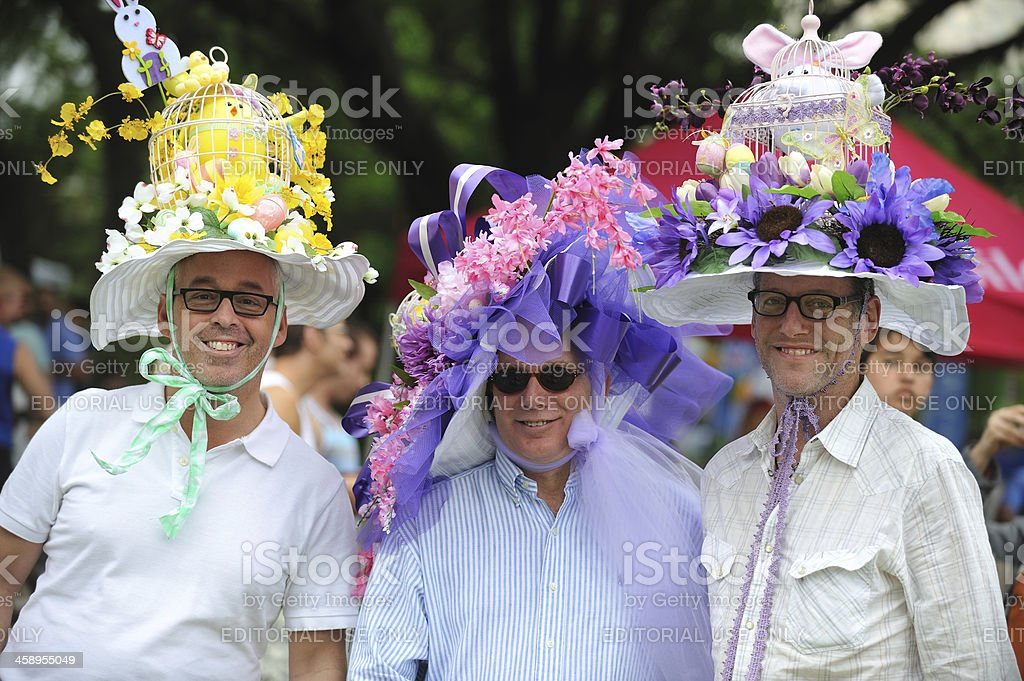 Three gay men with funny Easter hats. royalty-free stock photo